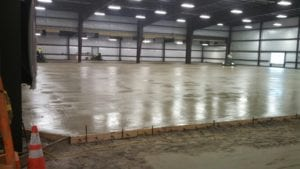 Concrete contractor Dayton, Toledo, Cleveland, Columbus Ohio, Pennsylvania, West Virginia we can save you time and money with our newest technology laser screed and riding power trowels.